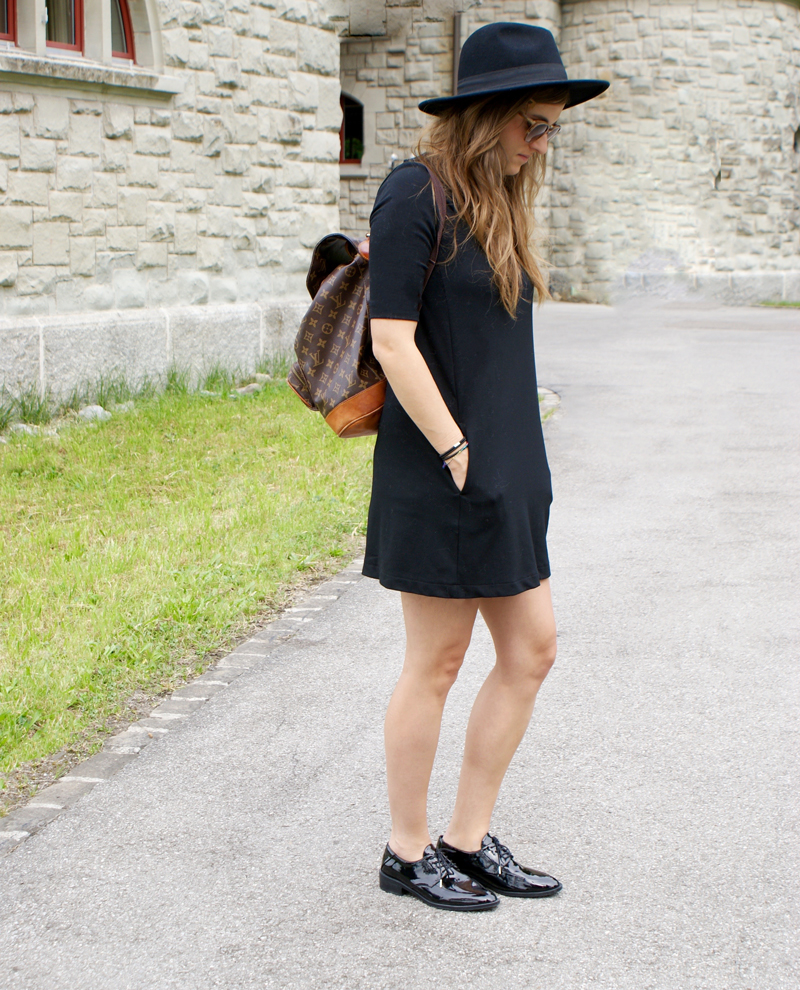 Black Dress with patent-leather shoes and a backpack from Louis Vuitton.
