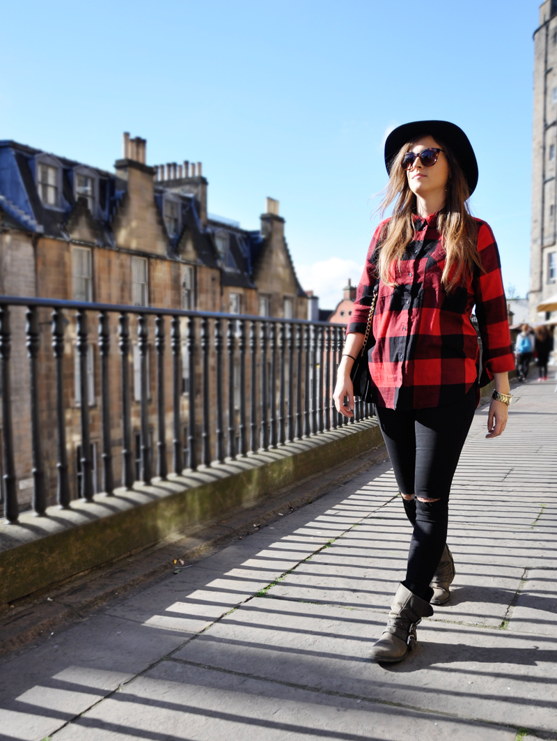 Check Style in Scotland. Checked shirt from American Eagle with black skinny jeans from Topshop. Boots from Steve Madden with Hat and Sunglasses from H&M.