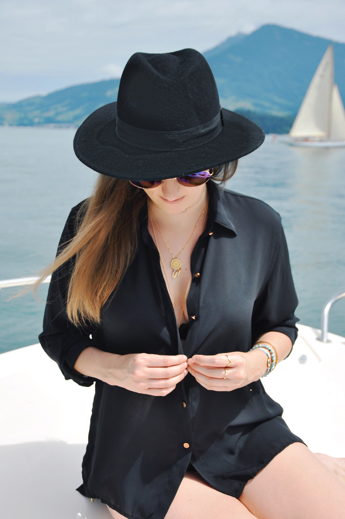 Fashionblogger, Andrea Steiner from Strawberries 'n' Champagne is wearing jewelry from NK Design in Zurich for a summer day. Combined with a blouse form H&M and Hat with Sunglasses.