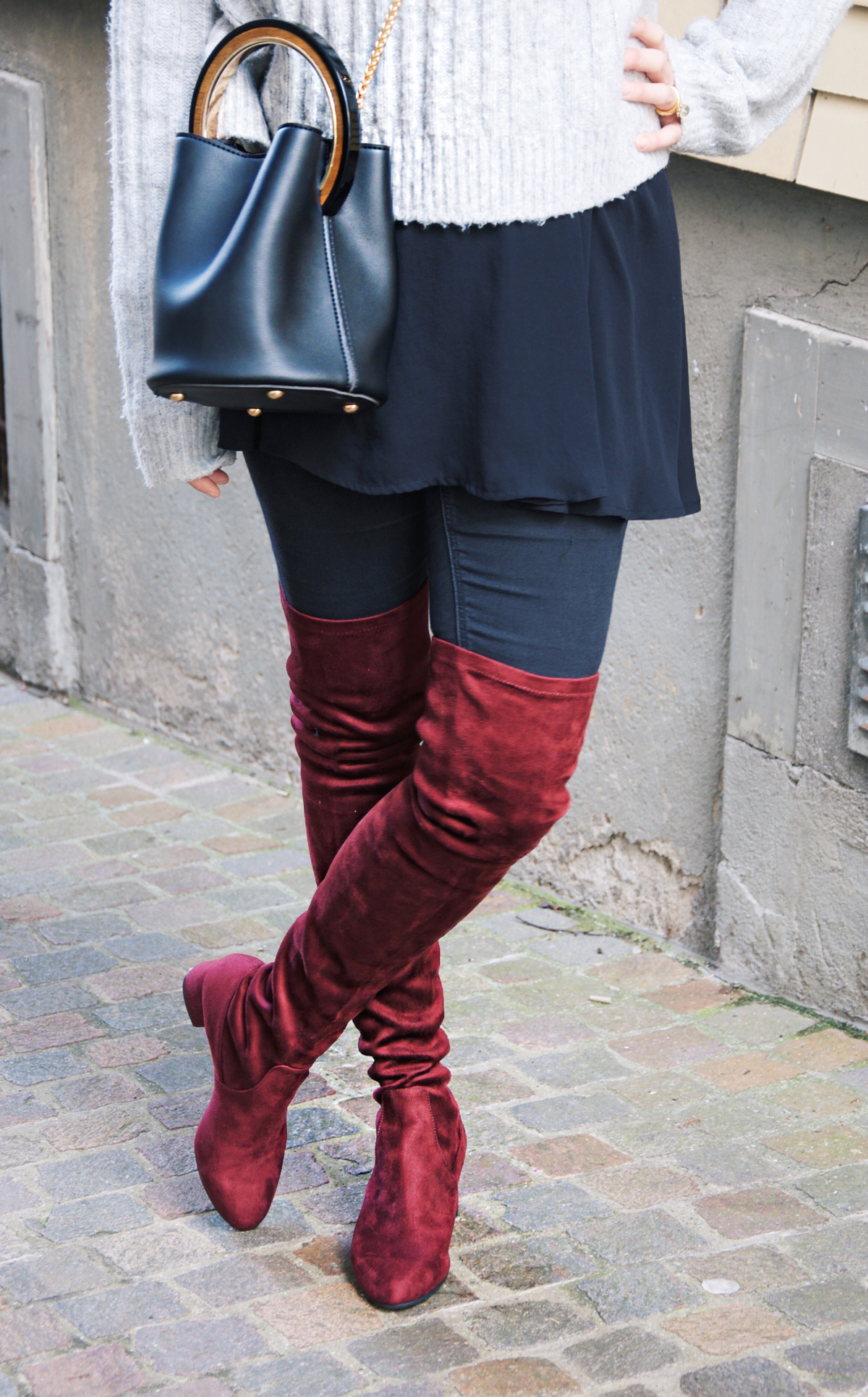 Andre Steiner, Fashion blogger from Strawberries 'n' Champagne wear red overknee boots from Steve Madden, Pants from Topshop and a sweaterf rom H&M. The bag is from a boutique in Hong Kong.