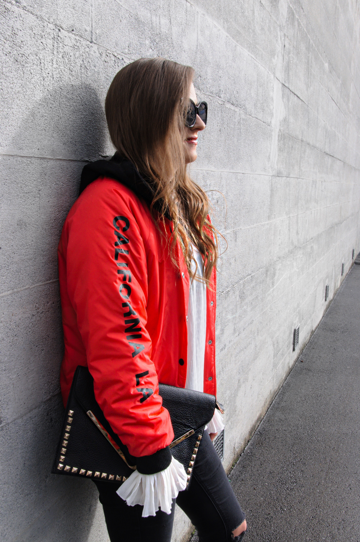 Andrea from fashion blog Strawberries n Champagne in Lucerne (Switzerland) wearing a red bomber jacket from Forever 21 for winter.