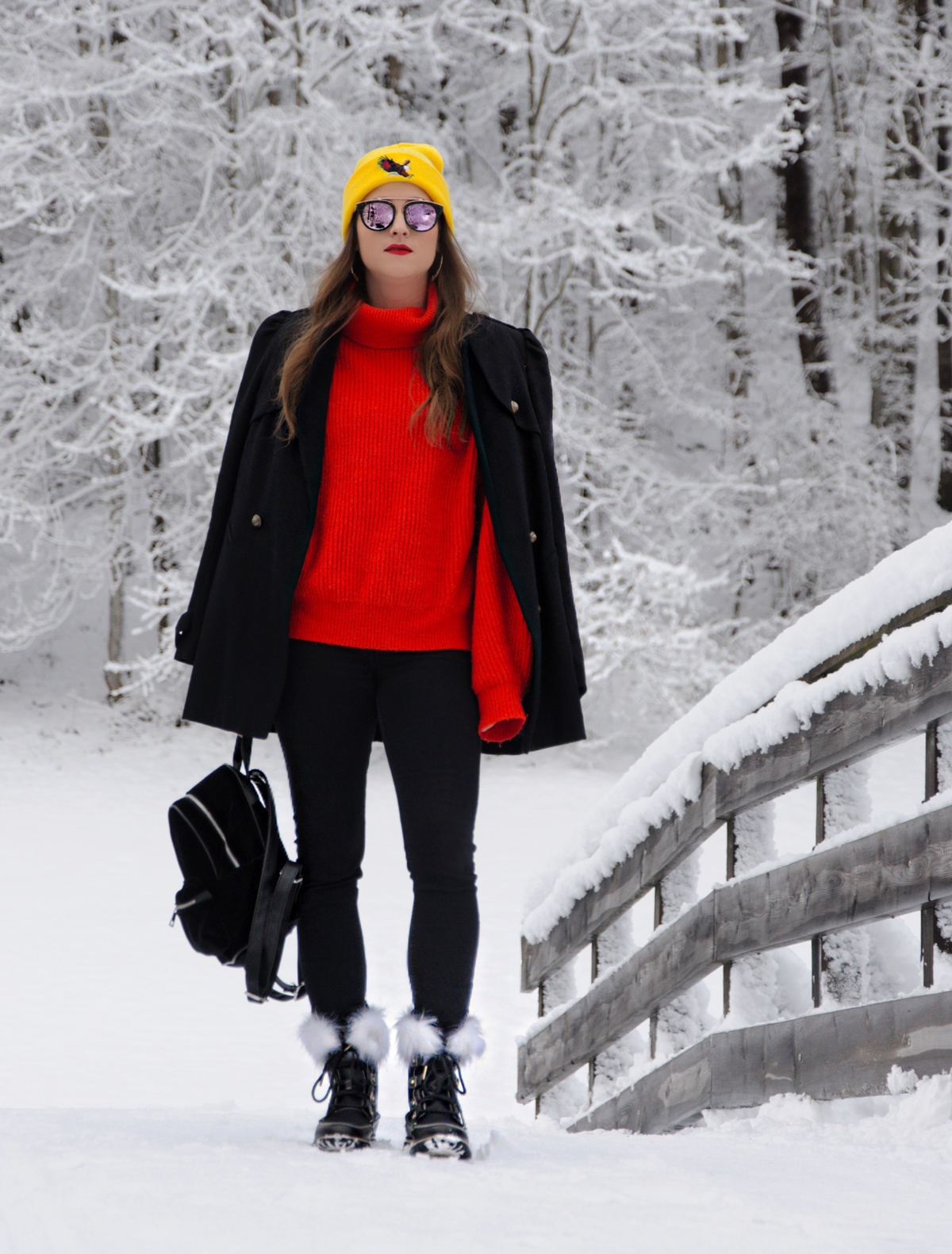 Swiss blogger for fashion Andrea Steiner from Strawberries 'n' Champagne wear new Sorel Boots for Winter in beautiful Engelberg.