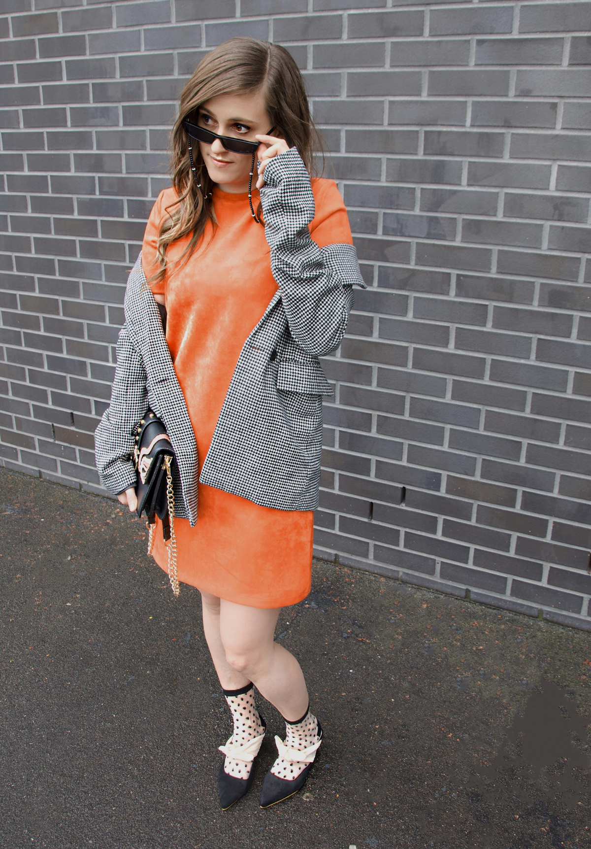 Andrea Steiner from fashion blog Strawberries 'n' Champagne based in Lucerne (Switzerland) wear a orange dress with a plaid blazer.