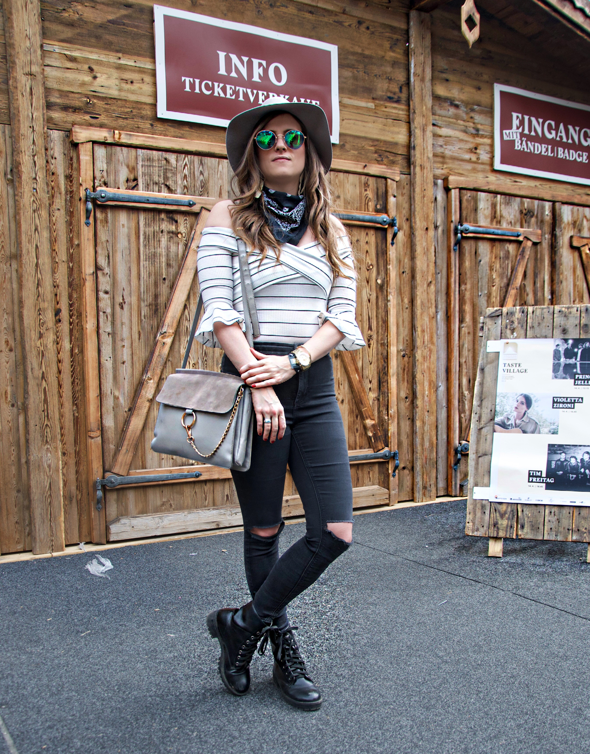 Andrea Steiner is a fashion blogger from Lucerne in Switzerland. On her blog Strawberries 'n' Champagne, she shows a festival Look for the Zermatt Unplugged Event. She is wearing black skinny pants by topshop, a shoulder off shirt by shein.com and a hat an d sunglasses by H&M.