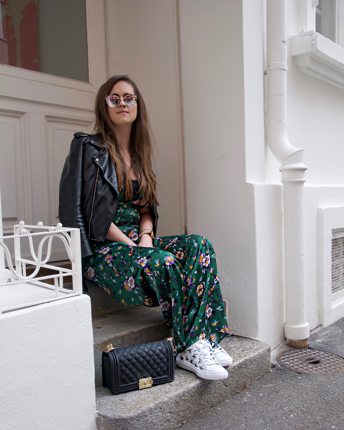 Strawberries & Champagne, a fashion Blog by Andrea Steiner based in Lucerne, Switzerland is wearing the perfect sunglasses by Silhouette Eyewear and a colorful jumpsuit.