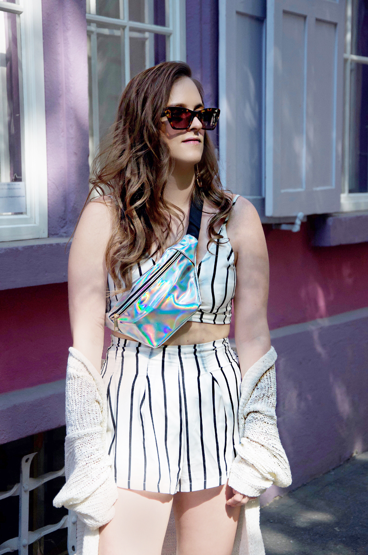 Andrea Steiner is fashion blogger from Lucerne in Switzerland. On her blog she write about new trends and stylings. Today a summer look with a black and white stripe set outfit, pink shoes and fanny pack.