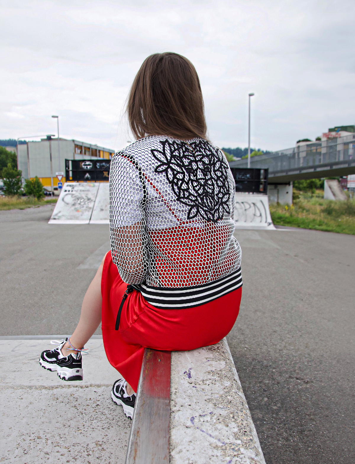 Layering Look with a red dress over a print shirt with sneakers and a small sunglasses. Trend Look for a casual day in Lucerne by Andrea from Strawberries 'n' Champagne.