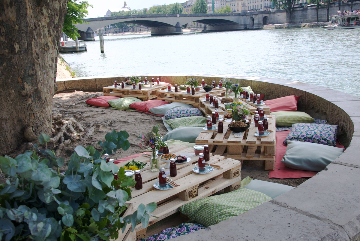 This wonderful boho style picnic next to the Seine at the Pont Royal, Right Bank in Paris