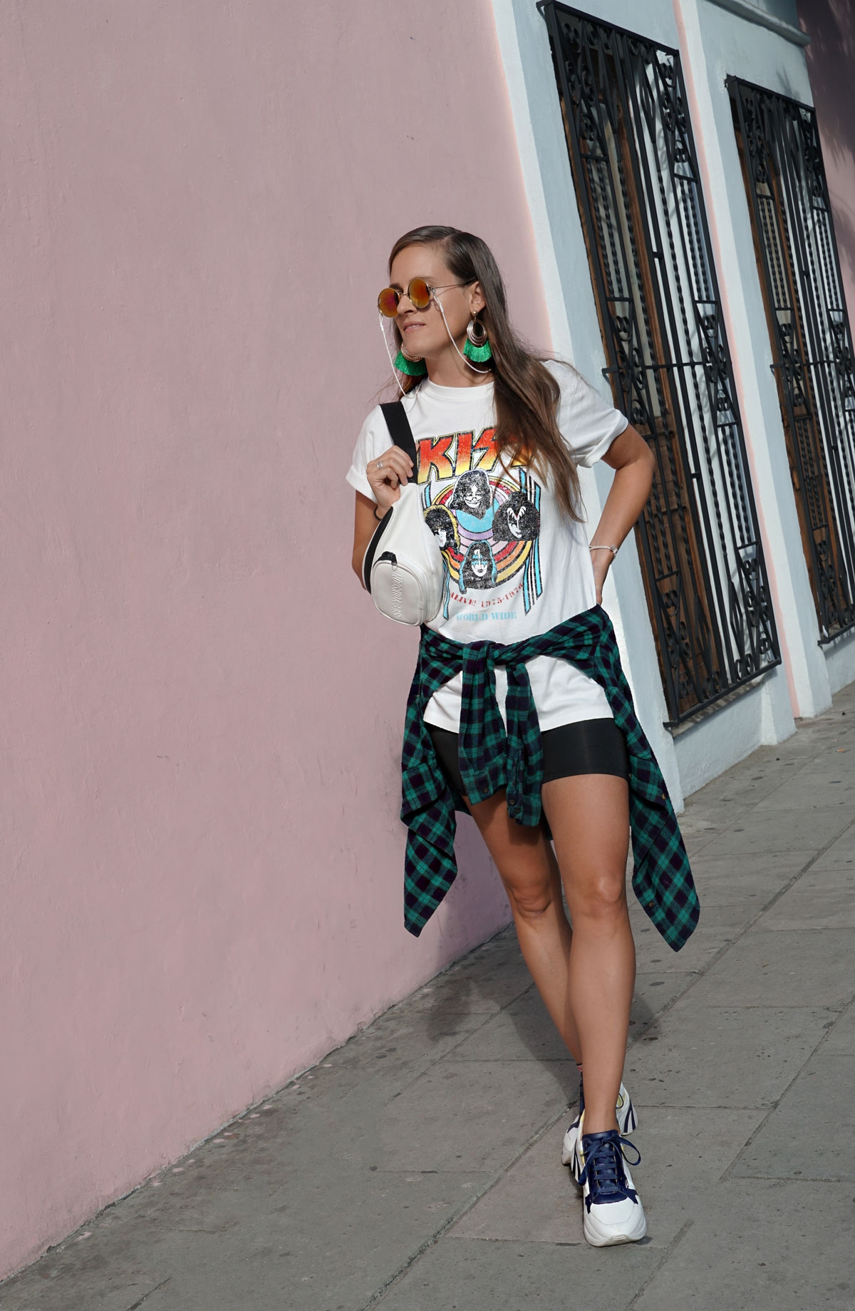 Andrea Steiner, fashion blogger from Strawberries 'n' Champagne based in Switzerland is wearing biker shorts with a band short from Kiss, plateau sneakers and a fanny pack.